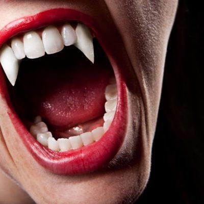 TikToker Super-Gluing Fake Vampire Fangs To Their Teeth For Halloween Hack